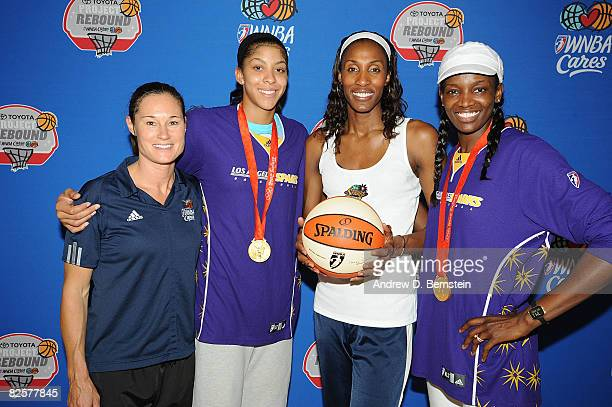Legend Jennifer Azzi poses for a photo with Candace Parker Lisa Leslie and Delisha MiltonJones of the Los Angeles Sparks during the 'Project Rebound'...