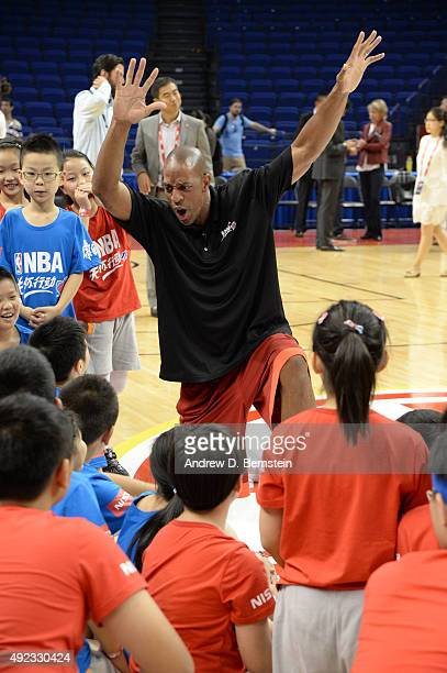 Legend Jerome Williams interacts with the kids during a NBA Cares clinic as part of the 2015 NBA Global Games China at the Mercedes Benz Arena on...