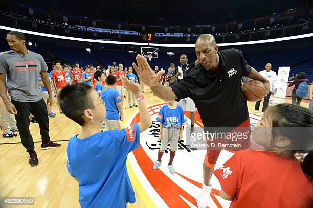 NBA legend Jerome Williams interacts with the kids during a NBA Cares clinic as part of the 2015 NBA Global Games China at the Mercedes Benz Arena on...