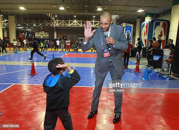 Legend John Starks encourages fans at the combine skills clinic during the 2014 NBA AllStar Jam Session at the Ernest N Morial Convention Center on...