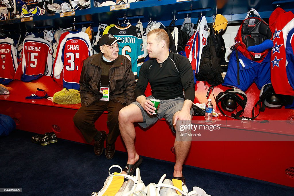 NHL legend Johnny Bower (L) talks with Eastern Conference All-Star Tim Thomas of the Boston Bruins at the McDonalds/NHL All-Star Open Practice during the 2009 NHL All-Star weekend at the Bell Centre on January 24, 2009 in Montreal, Canada.