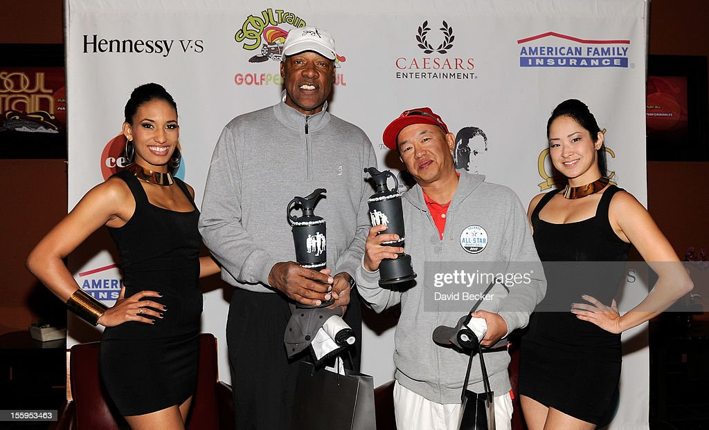 NBA legend Julius Erving (2nd L) and Hwa Wu (3rd L) attend the first annual Soul Train Celebrity Golf Invitational presented by Hennessy at the Las Vegas Paiute Golf Resort on November 9, 2012 in Las Vegas, Nevada.