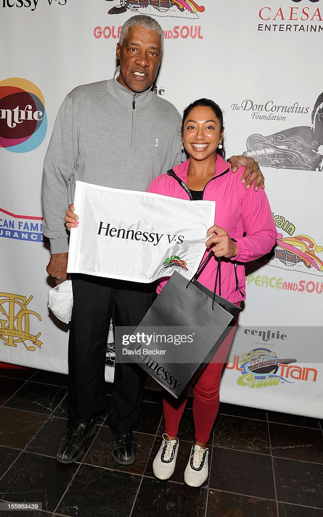 NBA legend Julius Erving (L) and Nisha Sadekar attend the first annual Soul Train Celebrity Golf Invitational presented by Hennessy at the Las Vegas Paiute Golf Resort on November 9, 2012 in Las Vegas, Nevada.