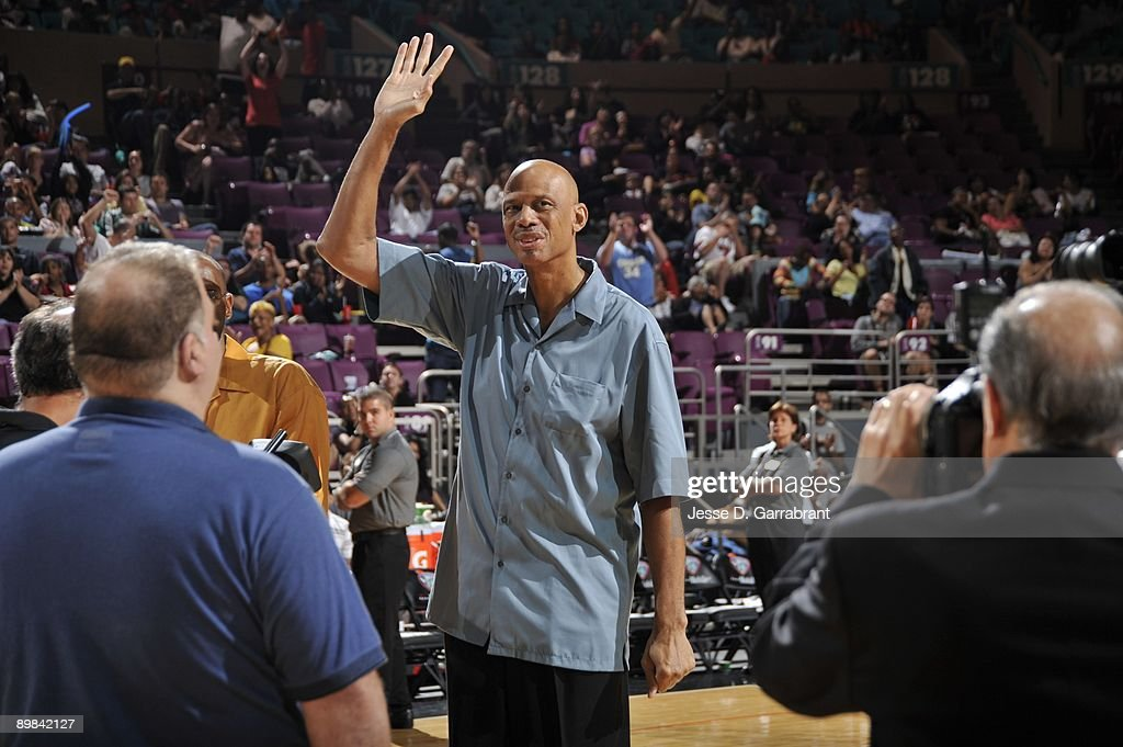 Legend Kareem Abdul Jabbar waves to the crowd during the WNBA New York Liberty game against the Chicago Sky on August 14 2009 at Madison Square...