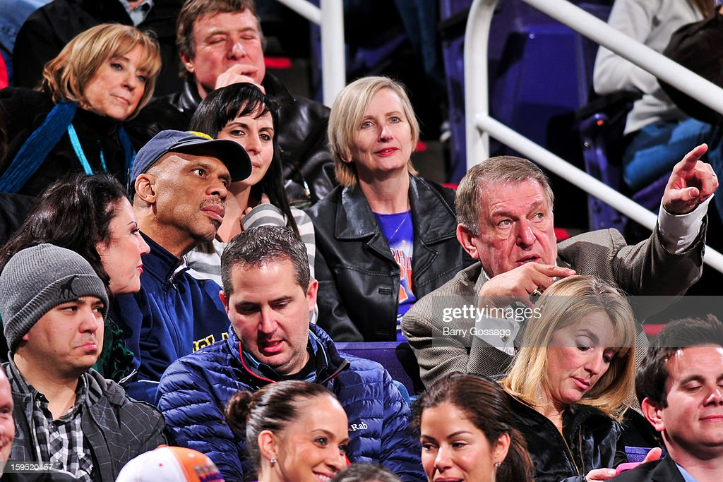 NBA legend Kareem Abdul-Jabbar, center left, speaks with former Phoenix Suns owner Jerry Colangelo, center right, during a game between the Oklahoma City Thunder and Suns on January 14, 2013 at U.S. Airways Center in Phoenix, Arizona.