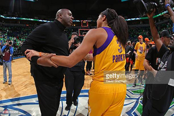 Legend Magic Johnson congratulates Candace Parker of the Los Angeles Sparks after Game Five of the 2016 WNBA Finals against the Minnesota Lynx on...