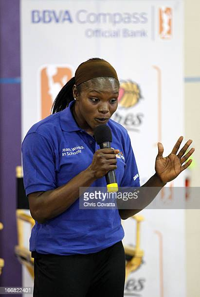 Legend Marie Ferdinand Harris encourages students to exercise during The WNBA Cares/BBVA Compass Team Works In Schools service project on April 16...