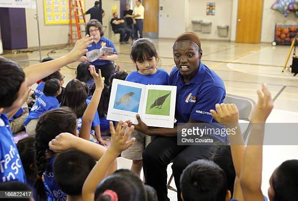 Legend Marie Ferdinand Harris reads to students during The WNBA Cares/BBVA Compass Team Works In Schools service project on April 16 2013 at the Will...