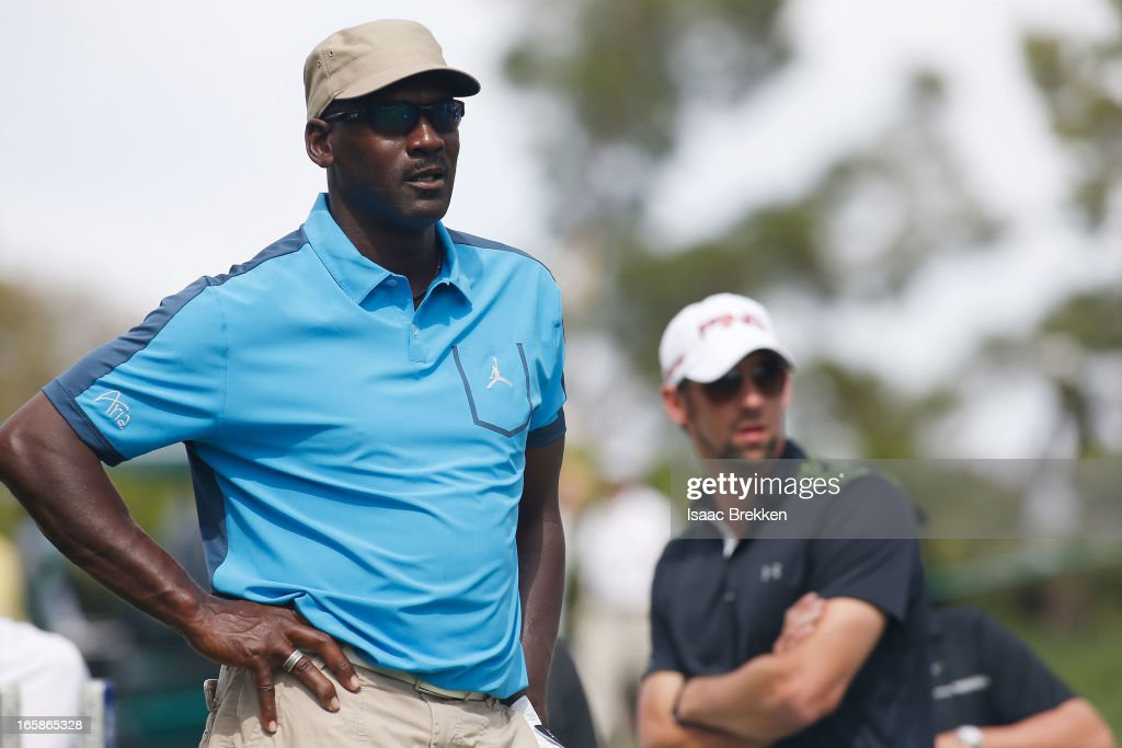 NBA legend <a gi-track='captionPersonalityLinkClicked' href=/galleries/search?phrase=Michael+Jordan+-+Basketball+Player&family=editorial&specificpeople=73625 ng-click='$event.stopPropagation()'>Michael Jordan</a> (L) and Olympic gold medalist <a gi-track='captionPersonalityLinkClicked' href=/galleries/search?phrase=Michael+Phelps&family=editorial&specificpeople=162698 ng-click='$event.stopPropagation()'>Michael Phelps</a> wait to hit during ARIA Resort & Casino's <a gi-track='captionPersonalityLinkClicked' href=/galleries/search?phrase=Michael+Jordan+-+Basketball+Player&family=editorial&specificpeople=73625 ng-click='$event.stopPropagation()'>Michael Jordan</a> Celebrity Invitational golf tournament at Shadow Creek on April 6, 2013 in North Las Vegas, Nevada.