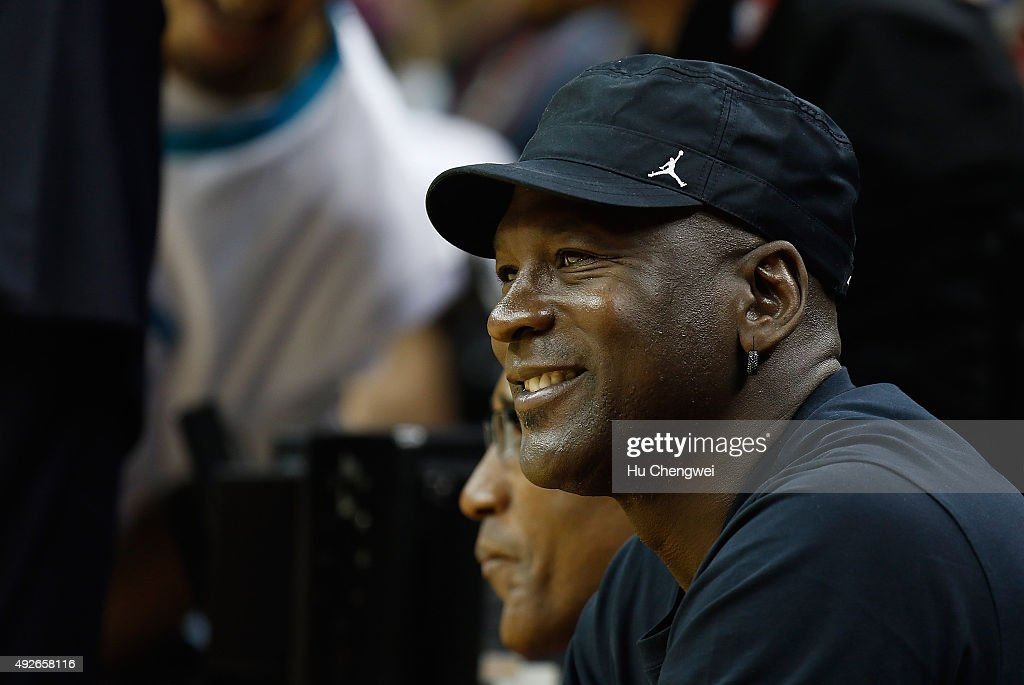 NBA legend Michael Jordan, smiles during a NBA game between Charlotte Hornets and Los Angeles Clippers at Mercedes-Benz Arena on October 14, 2015 in Shanghai, China.