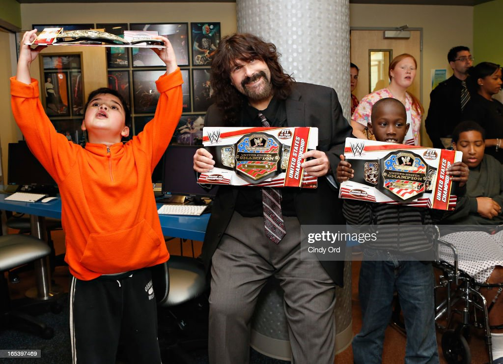 WWE Legend Mick Foley surprises children with a visit to St. Mary's Hospital For Children on April 3, 2013 in New York City.