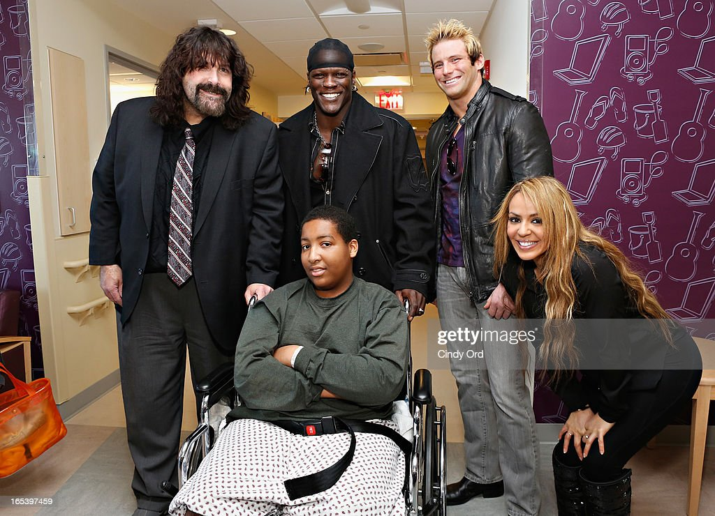 WWE Legend Mick Foley, WWE Superstar R-Truth, WWE Superstar Zack Ryder and WWE Diva Layla El visit with patients at St. Mary's Hospital For Children on April 3, 2013 in New York City.