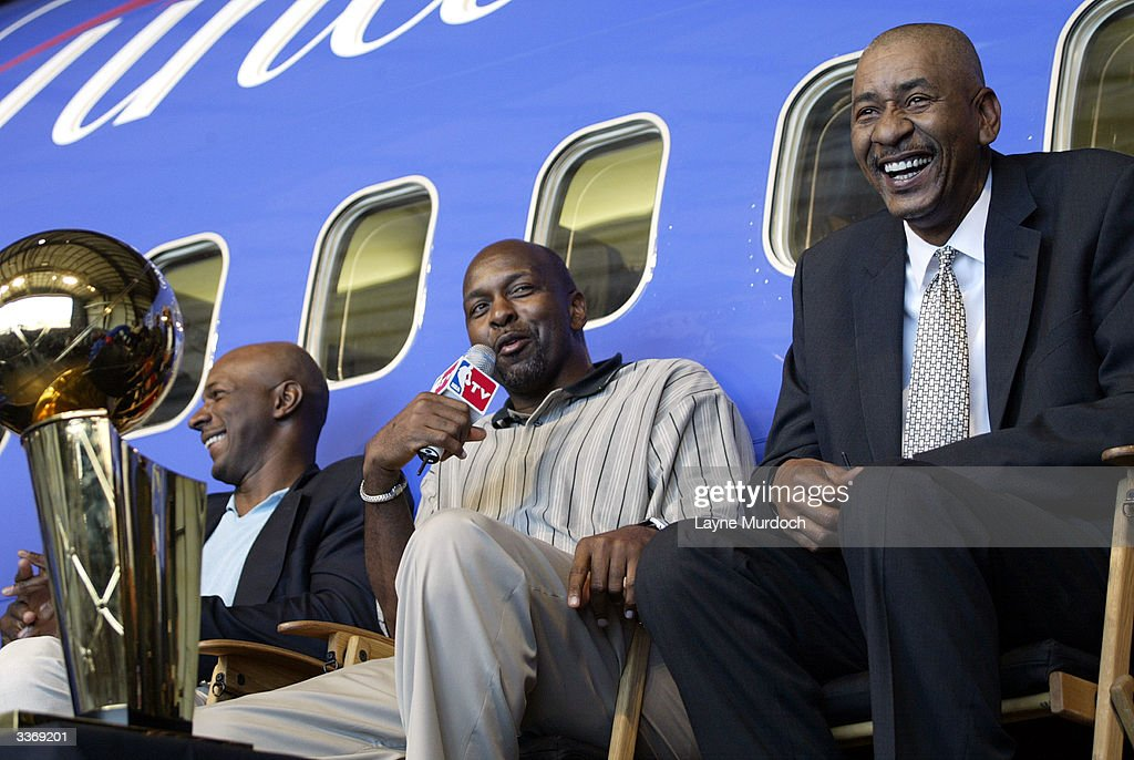 NBA legend <a gi-track='captionPersonalityLinkClicked' href=/galleries/search?phrase=Moses+Malone&family=editorial&specificpeople=213188 ng-click='$event.stopPropagation()'>Moses Malone</a> (C) gets a laugh from Clyde Drexler (L) and George Gervin (R) during the NBA Legends Tour: Destination Finals at the Southwest Airlines headquarters in Dallas, Texas.