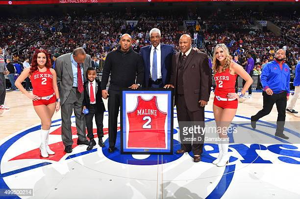 Legend Moses Malones Jersey of the Philadelphia 76ers is shared with the fans during halftime against the Los Angeles Lakers at Wells Fargo Center on...