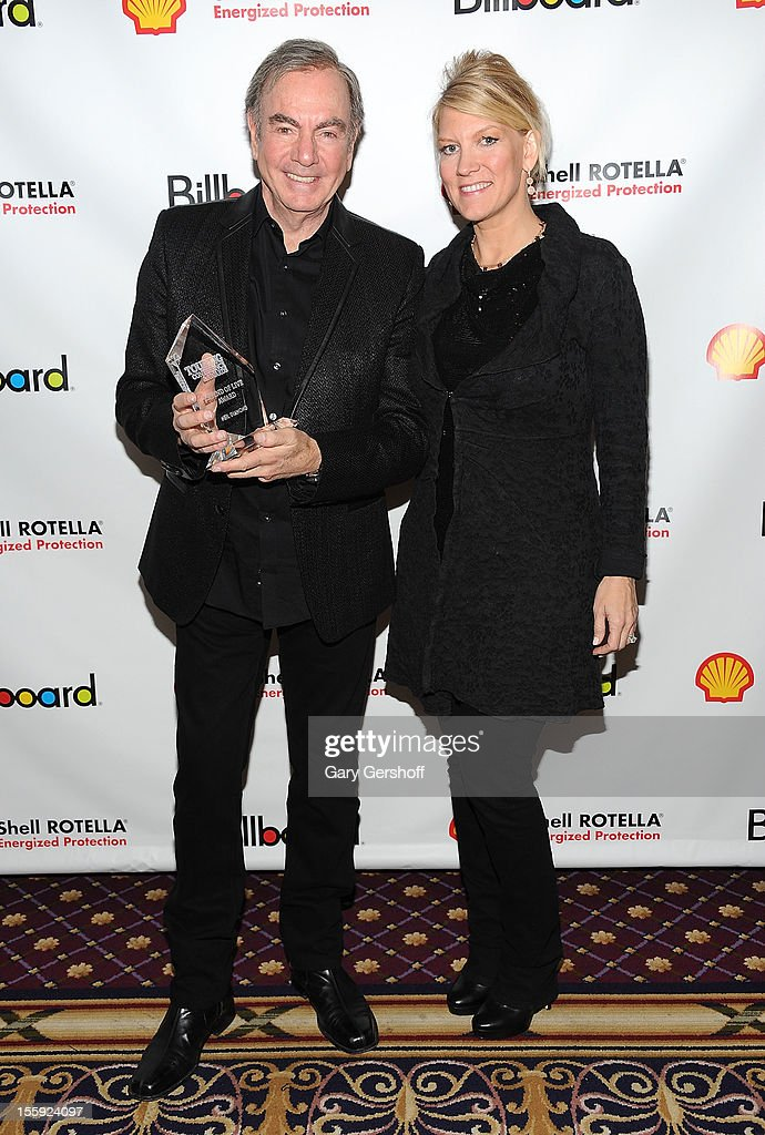 'Legend of Live' award recipient <a gi-track='captionPersonalityLinkClicked' href=/galleries/search?phrase=Neil+Diamond&family=editorial&specificpeople=210635 ng-click='$event.stopPropagation()'>Neil Diamond</a> (L) and wife Katie Mc<a gi-track='captionPersonalityLinkClicked' href=/galleries/search?phrase=Neil+Diamond&family=editorial&specificpeople=210635 ng-click='$event.stopPropagation()'>Neil Diamond</a> attend the 2012 Billboard Touring Awards Reception at The Roosevelt Hotel on November 8, 2012 in New York City.