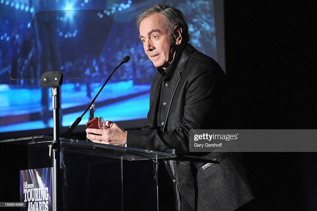 'Legend of Live' award recipient <a gi-track='captionPersonalityLinkClicked' href=/galleries/search?phrase=Neil+Diamond&family=editorial&specificpeople=210635 ng-click='$event.stopPropagation()'>Neil Diamond</a> speaks on stage at the 2012 Billboard Touring Awards at The Roosevelt Hotel on November 8, 2012 in New York City.