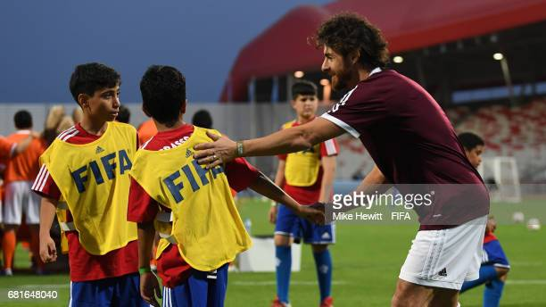 Legend Pablo Aimar takes part during a grassroots training sesson with local children at the Bahrain National Stadium ahead of the 67th FIFA Congress...
