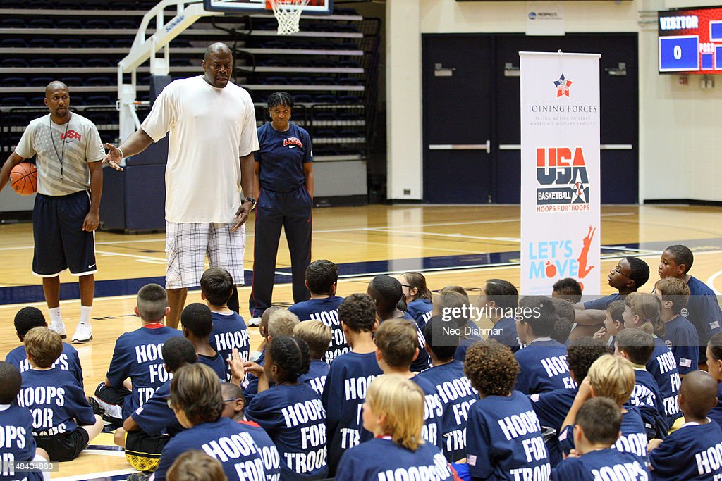 NBA legend Patrick Ewing speaks to participants during a Hoops for Troops clinic after USA Men's Senior National Team practice at George Washington University during USA Men's Senior National Team training camp at on July 14, 2012 in Washington, DC.