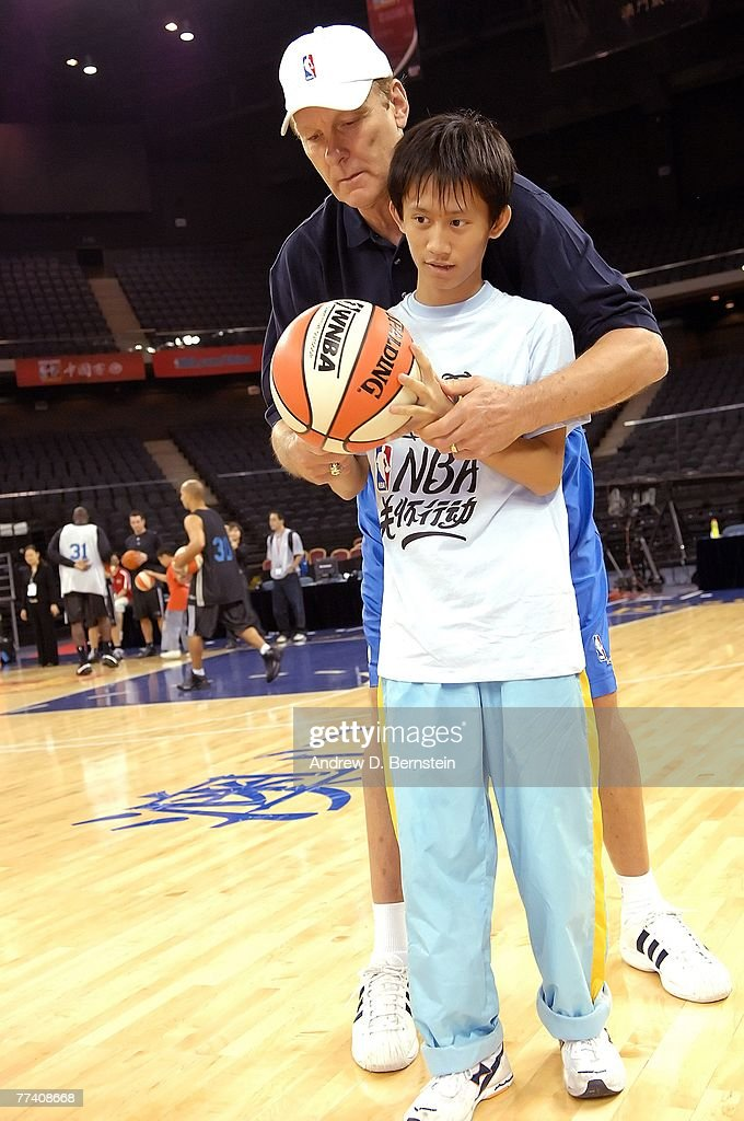 Legend Rick Barry works with a participant of a NBA Cares Special Olympics Basketball Clinic as part of the 2007 NBA China Games on October 19 2007...