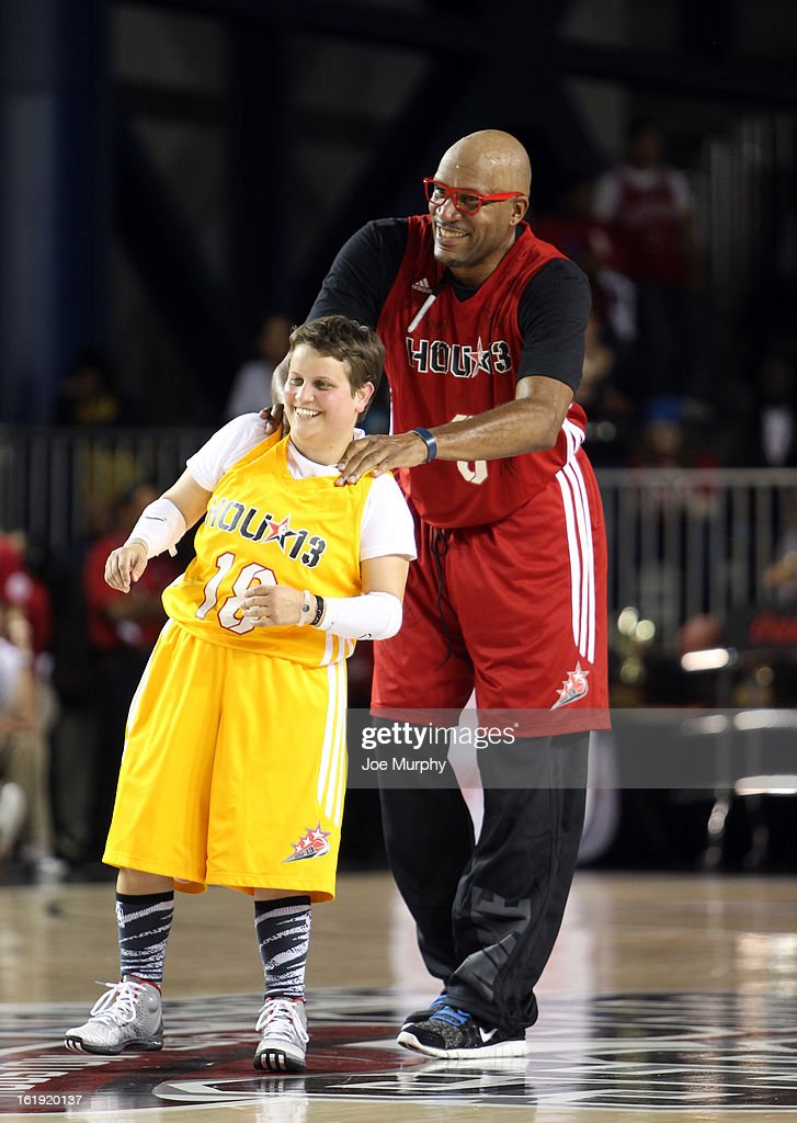 NBA Legend <a gi-track='captionPersonalityLinkClicked' href=/galleries/search?phrase=Ron+Harper&family=editorial&specificpeople=206559 ng-click='$event.stopPropagation()'>Ron Harper</a> interacts with a player during the NBA Cares Special Olympics Unity Sports Basketball Game on Center Court during the 2013 NBA Jam Session on February 17, 2013 at the George R. Brown Convention Center in Houston, Texas.