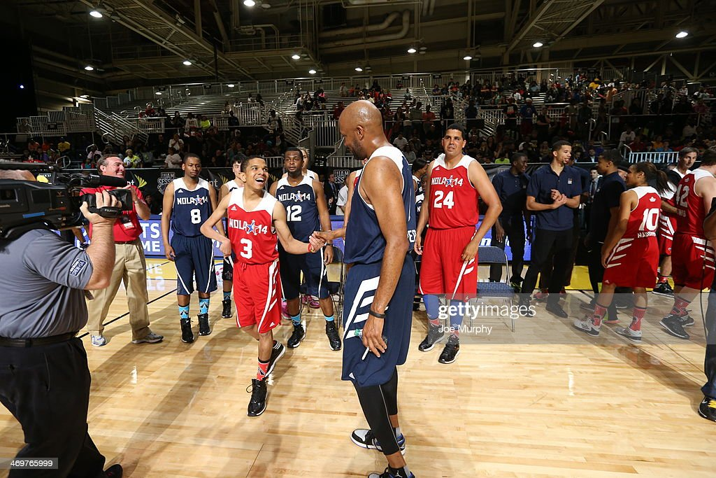 NBA Legend <a gi-track='captionPersonalityLinkClicked' href=/galleries/search?phrase=Ron+Harper&family=editorial&specificpeople=206559 ng-click='$event.stopPropagation()'>Ron Harper</a> of the East Team high-fives a player of the West Team during the NBA Cares Special Olympics Unified Sports Basketball Game at Sprint Arena during the 2014 NBA All-Star Jam Session at the Ernest N. Morial Convention Center on February 16, 2014 in New Orleans, Louisiana.