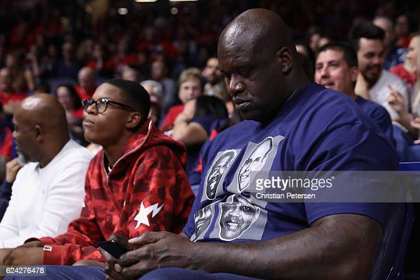 NBA legend Shaquille O'neal and son Shareef attend the college basketball game between the Arizona Wildcats and the Sacred Heart Pioneers at McKale...