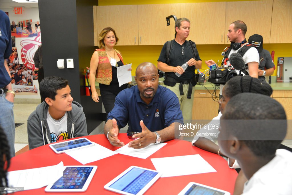Legend Tim Hardaway of the Miami Heat interacts with the kid at the 2014 NBA Finals Legacy Project as part of the 2014 NBA Finals on June 11, 2014 at the Little Haiti Cultural Complex in Miami, Florida.