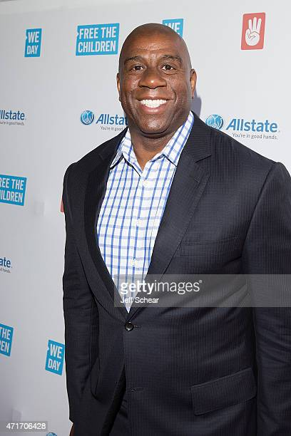 NBA legend twotime HallofFamer entrepreneur and philanthropist Earvin 'Magic' Johnson walks the We Day Red Carpet at We Day Illinois 2015 at Allstate...