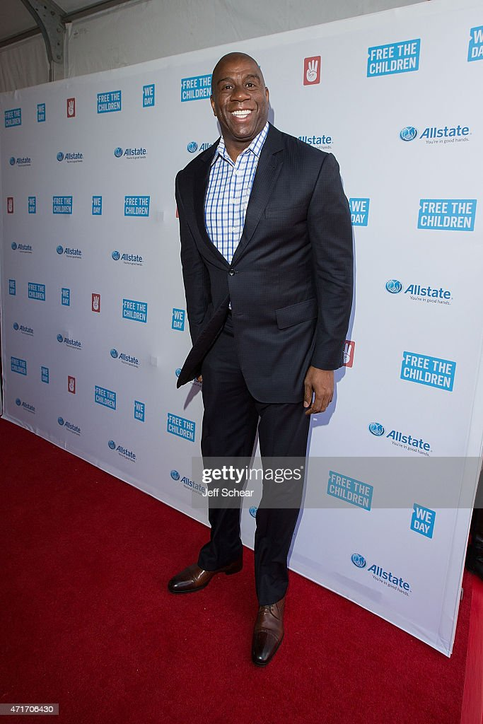 NBA legend twotime HallofFamer entrepreneur and philanthropist Earvin 'Magic' Johnson walks the We Day Red Carpet at We Day Illinois 2015 at Allstate...