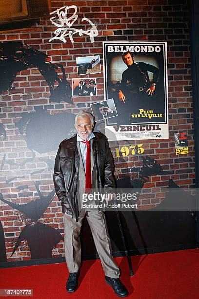 Legendary actor JeanPaul Belmondo poses by a poster of the 1975 thriller 'Peur sur la ville' by Henri Verneuil in which he stars a Paris police chief...