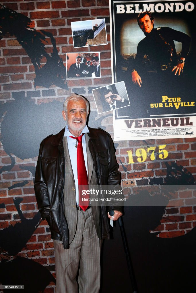 Legendary actor <a gi-track='captionPersonalityLinkClicked' href=/galleries/search?phrase=Jean-Paul+Belmondo&family=editorial&specificpeople=207029 ng-click='$event.stopPropagation()'>Jean-Paul Belmondo</a> poses by a poster of the 1975 thriller 'Peur sur la ville' by Henri Verneuil, in which he stars a Paris police chief, as he attends the '100th Anniversary Of The Paris Judiciary Police' exhibition opening on November 8, 2013 in Paris, France.