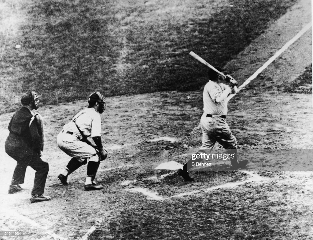 Legendary American baseball player Babe Ruth of the New York Yankees hits a home run in the third game of the World Series against the Chicago Cubs...