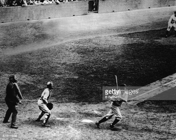 Legendary American baseball player Babe Ruth of the New York Yankees hits his 60th home run of the season against Washington Senators' pitcher Tom...