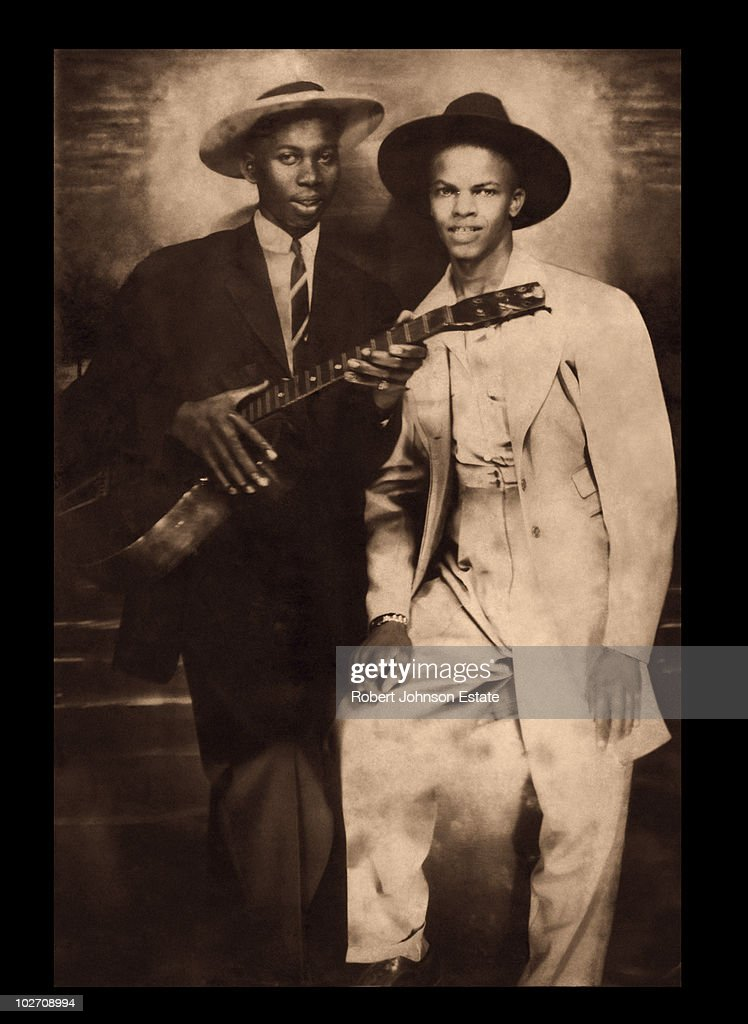 Legendary American blues singersongwriter and guitarist Robert Johnson left with fellow blues musician Johnny Shines circa 1935 This image one of...