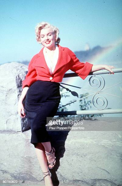 Legendary American film actress Marilyn Monroe poses against a railing
