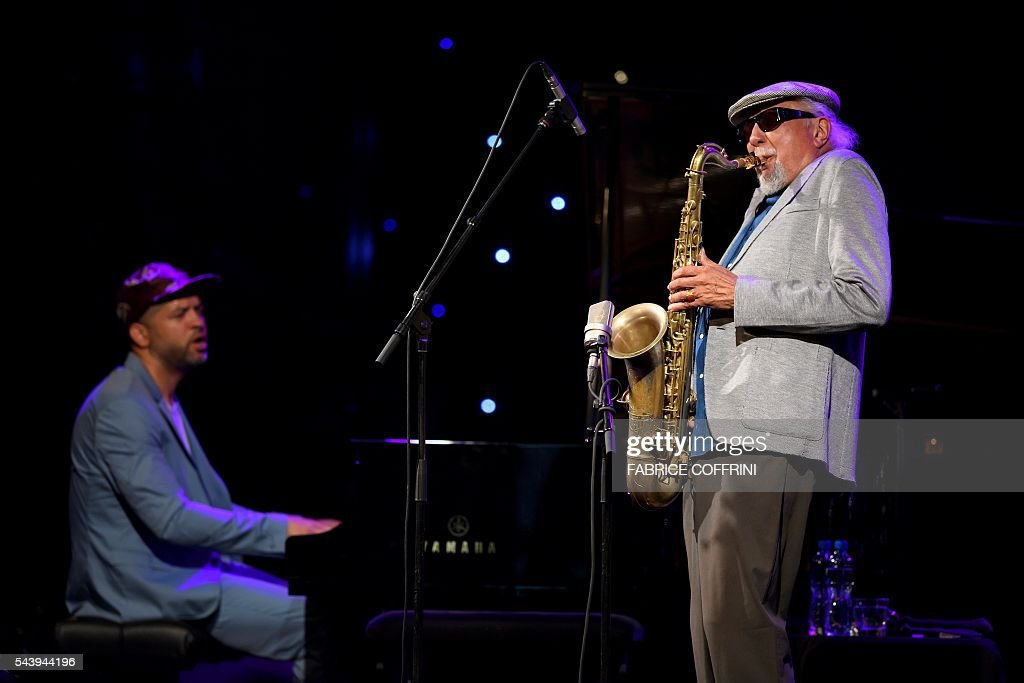 Legendary American jazz musician Charles Lloyd, who headlined the first festival in Montreux in 1967 performs on stage at the opening of the 50 edition of the Montreux Jazz Festival on June 30, 2016 in Montreux. Two of the world's greatest jazz musicians opened the star-studded 50th edition of the Montreux Jazz Festival on Thursday, with big names such as Neil Young and PJ Harvey also set to perform at this year's anniversary event. / AFP / FABRICE