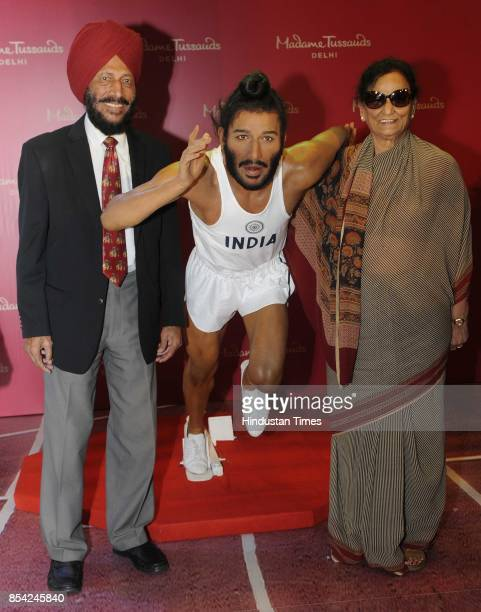 Legendary athlete Milkha Singh with wife Nirmal Kaur unveils his wax statue for Madame Tussauds Museum on September 26 2017 in Chandigarh India...