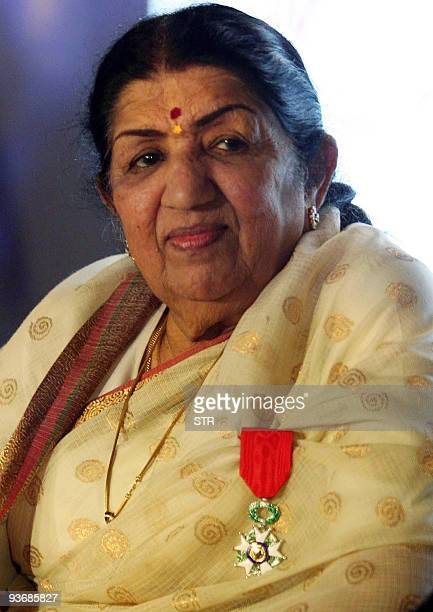 Legendary Bollywood singer Lata Mangeshkar wears her medal at a function in Mumbai late evening December 2 2009 The 80yearold performer was awarded...