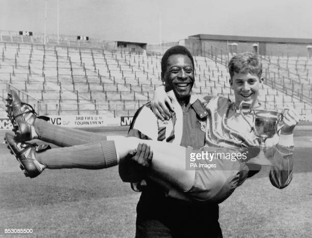 Legendary Brazilian footballer Pele giving his support to the Young Player of the Year Graham Connell of Victoria Drive School at Hampden Park...