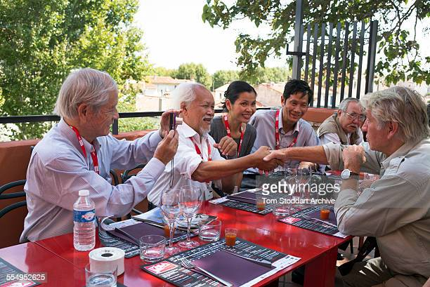 Legendary British war photographer Don McCullin pictured right with four Vietnamese photographers who covered the war with the North Vietnamese...