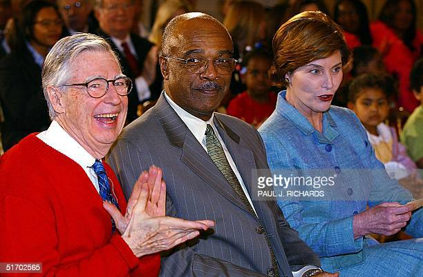 Legendary children's television star Fred Rogers joins US Secretary of Education Rod Paige and US First Lady Laura Bush 03 April 2002 in the East...
