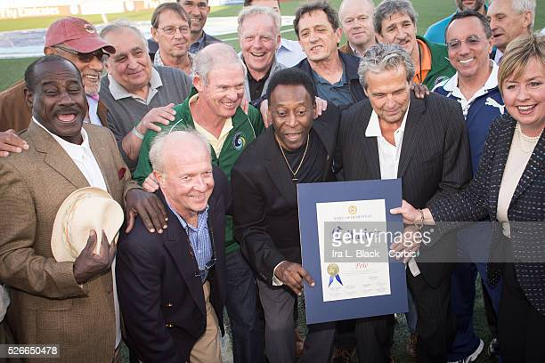 Legendary Cosmos and Brazil player Pele receives an award with former Cosmos players by his side prior to the Soccer 2015 NASL NY Cosmos vs Tampa Bay...