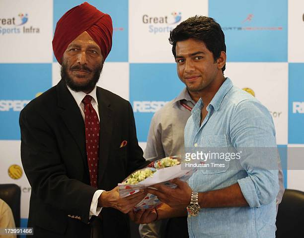 Legendary Flying Sikh former athlete Milkha Singh along with Under19 Cricket Captain Unmukt Chand during a press conference on SportsMentor's launch...