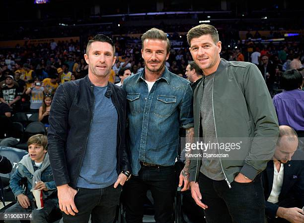 Legendary footballers Robbie Keane David Beckham and Steven Gerrard pose during a basketball game between the Boston Celtics and the Los Angeles...