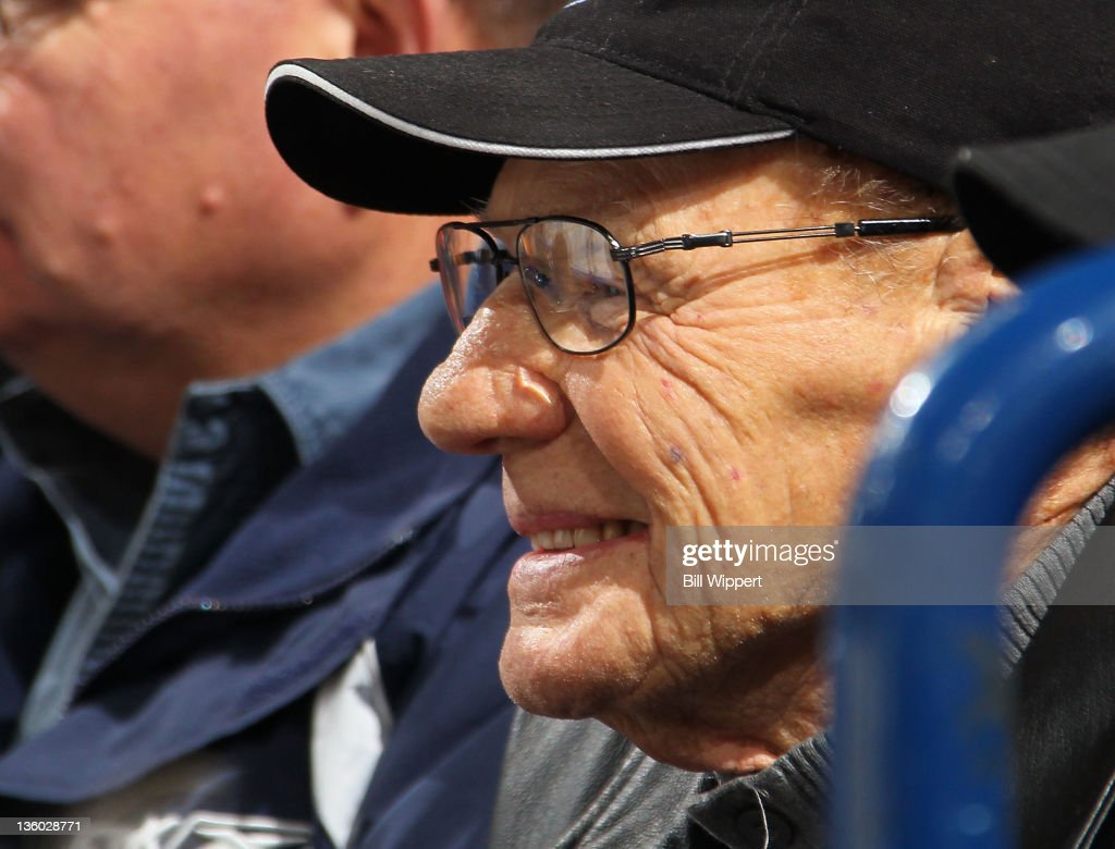 Legendary former goaltender Johnny Bower of the Toronto Maple Leafs watches the game between the Maple Leafs and the Buffalo Sabres at First Niagara Center on December 16, 2011 in Buffalo, New York.