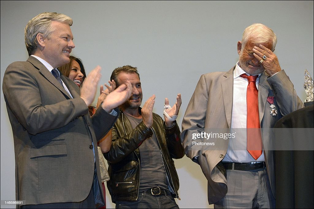 Legendary French actor <a gi-track='captionPersonalityLinkClicked' href=/galleries/search?phrase=Jean-Paul+Belmondo&family=editorial&specificpeople=207029 ng-click='$event.stopPropagation()'>Jean-Paul Belmondo</a> with Belgian Minister <a gi-track='captionPersonalityLinkClicked' href=/galleries/search?phrase=Didier+Reynders&family=editorial&specificpeople=548982 ng-click='$event.stopPropagation()'>Didier Reynders</a> while receiving the Order of King Leopold for his Life Achievement on June 19, 2012 in Brussels, Belgium. The Order of Leopold is one of three Belgian Knighthoods that can be granted and is the highest order of Belgium