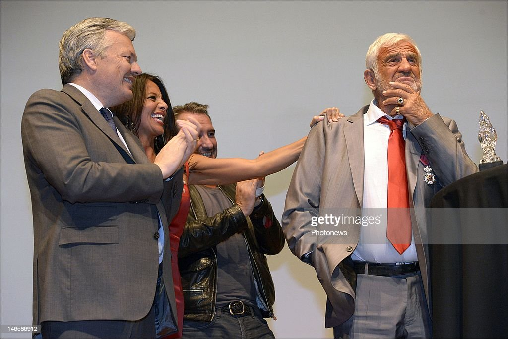 Legendary French actor <a gi-track='captionPersonalityLinkClicked' href=/galleries/search?phrase=Jean-Paul+Belmondo&family=editorial&specificpeople=207029 ng-click='$event.stopPropagation()'>Jean-Paul Belmondo</a> with Belgian Minister <a gi-track='captionPersonalityLinkClicked' href=/galleries/search?phrase=Didier+Reynders&family=editorial&specificpeople=548982 ng-click='$event.stopPropagation()'>Didier Reynders</a> and his girlfriend <a gi-track='captionPersonalityLinkClicked' href=/galleries/search?phrase=Barbara+Gandolfi&family=editorial&specificpeople=5661747 ng-click='$event.stopPropagation()'>Barbara Gandolfi</a> while receiving the Order of King Leopold for his Life Achievement on June 19, 2012 in Brussels, Belgium. The Order of Leopold is one of three Belgian Knighthoods that can be granted and is the highest order of Belgium
