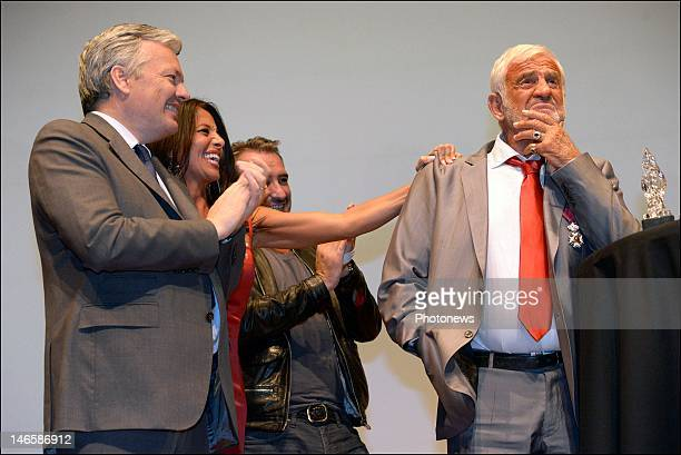 Legendary French actor JeanPaul Belmondo with Belgian Minister Didier Reynders and his girlfriend Barbara Gandolfi while receiving the Order of King...