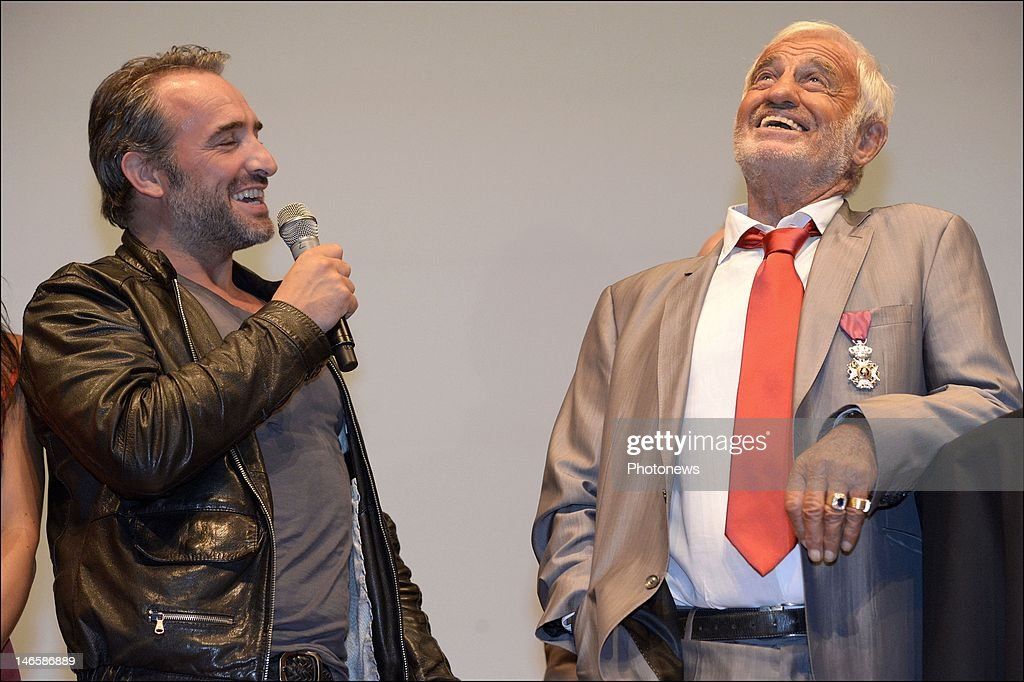 Legendary French actor Jean-Paul Belmondo with French actor Jean Dujardin while receiving the Order of King Leopold for his Life Achievement on June 19, 2012 in Brussels, Belgium. The Order of Leopold is one of three Belgian Knighthoods that can be granted and is the highest order of Belgium