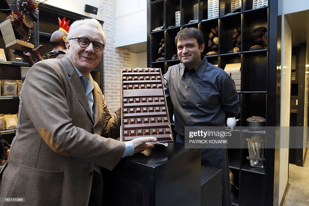 Legendary French chef Alain Ducasse (L) poses with his associate Nicolas Berger, chocolate maker and roaster, director of the 'Manufacture de chocolat' (Chocolate Factory) on February 19, 2013 in Paris.